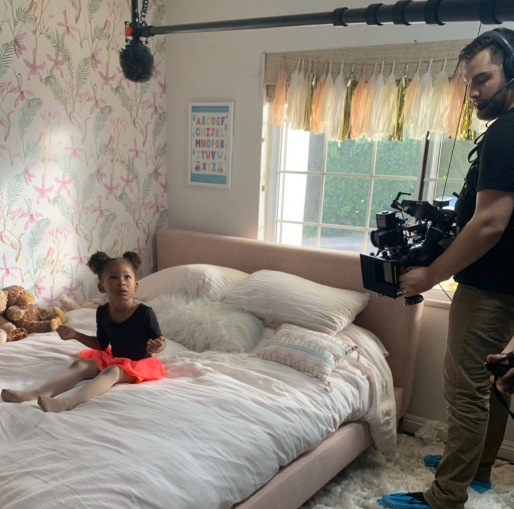 Little girl in her room behind the scenes