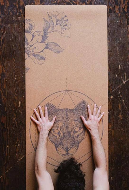 hands in childs pose on Scoria Mountain Lion cork mat
