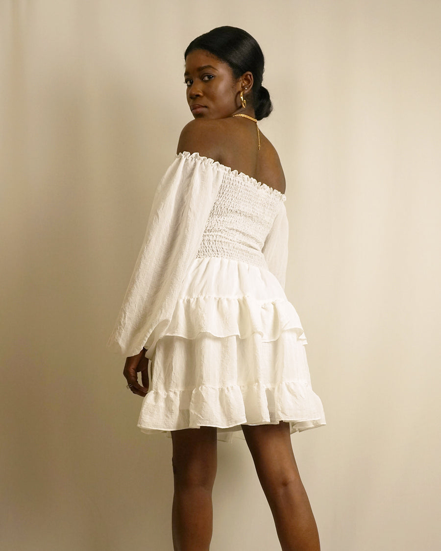 white off the shoulder frill cut out ruffle dress