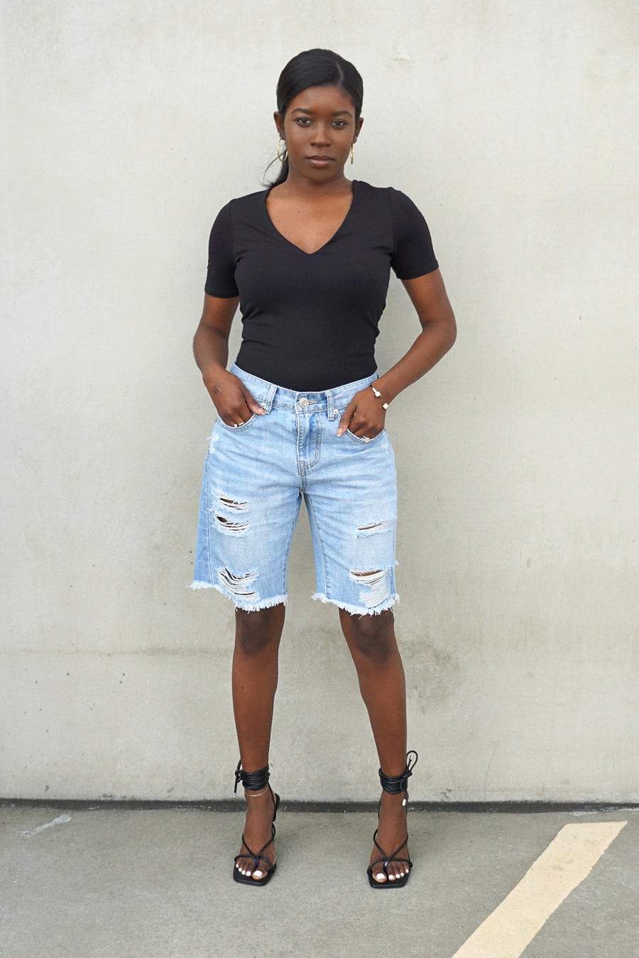 light blue distressed denim bermuda shorts