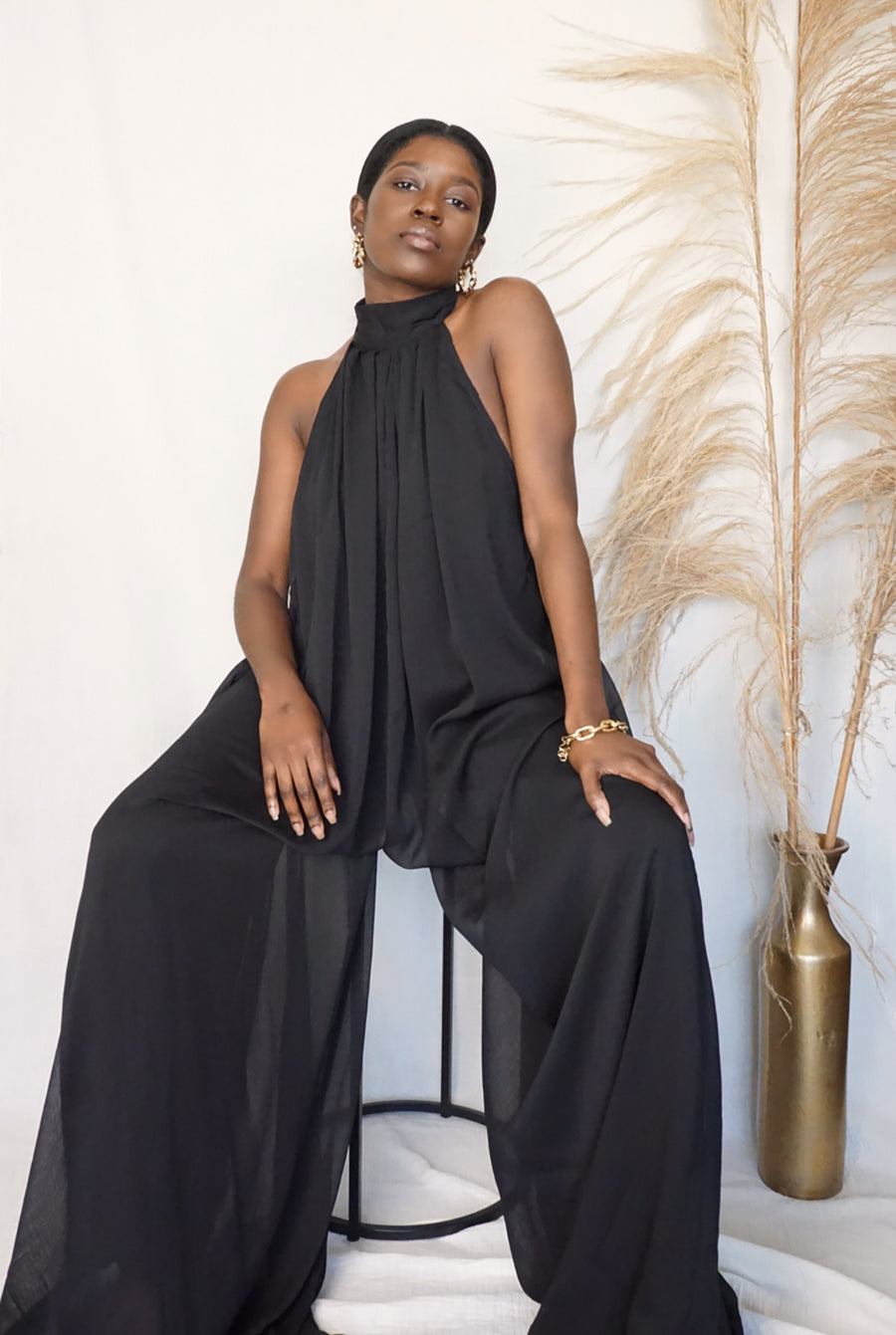 black halter neck open back wide leg jumpsuit with pockets