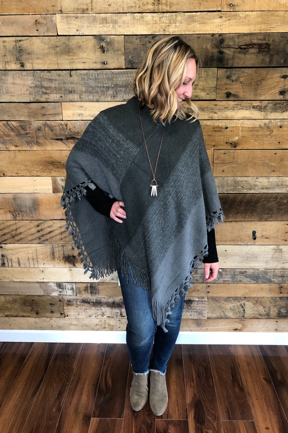 poncho with tassel hemline