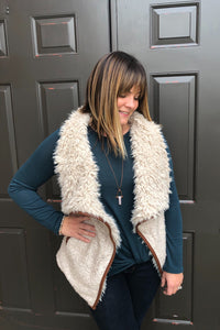 boucle vest with pockets and faux fur lining