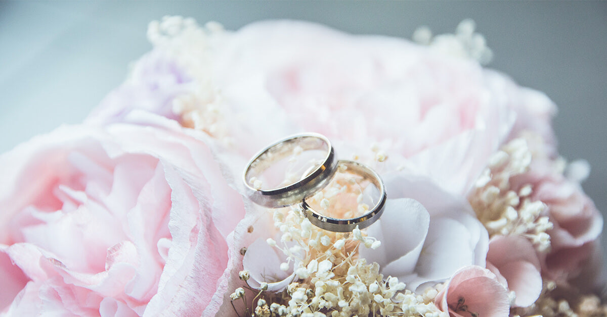 Pastel Roses with two Wedding Rings