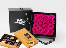 Mother's Day Stunning bright pink infinity roses, beautifully presented in a black box & Gold Godiva Chocolates
