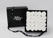 Stunning white cream infinity roses, beautifully presented in a black box