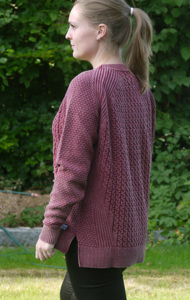 Dusty Burgundy Red Loose Fit Pullover with Knitted Cables for Women from Piece of Blue. On model. Back.