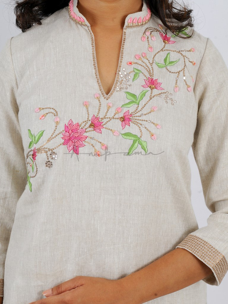 kurta in Jute silk with lotus sprig, sequins with matching cotton pants