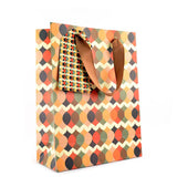 RUM AND ROULETTE gift bag with brown ribbon handles, a gift tag & red issue