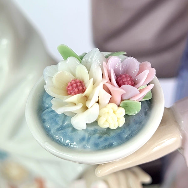 Take a Guess at What Type of Figurine This Little Bouquet Rests In?
