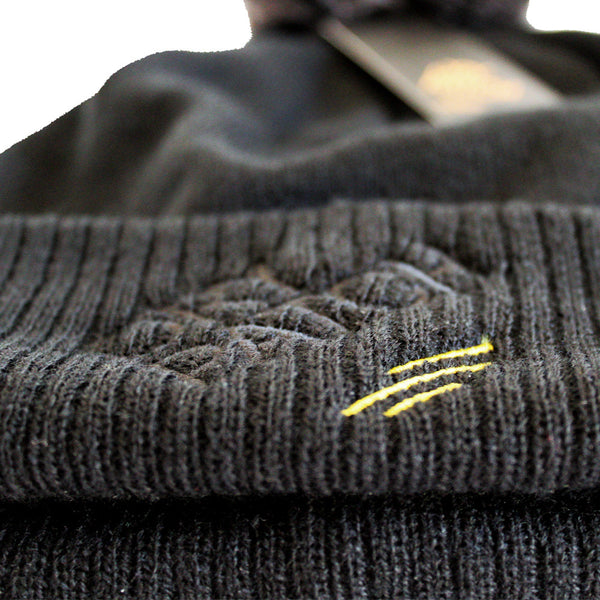 The Dry Patch Bobble Hat logo