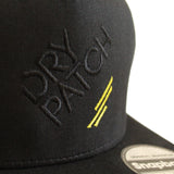 The Dry Patch Snapback cap up close