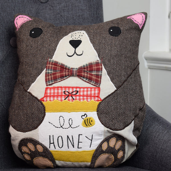 Billy the Bear Honeypot Cushion On Chair