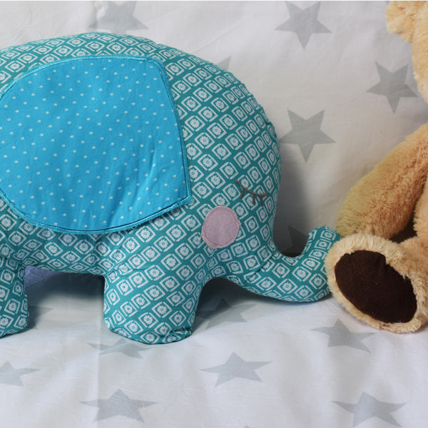 Edward the Sleepy Elephant Cushion on bed