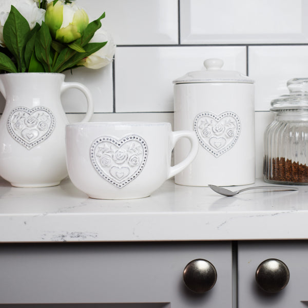 Floral Love Heart Ceramic Mug in kitchen with flowers