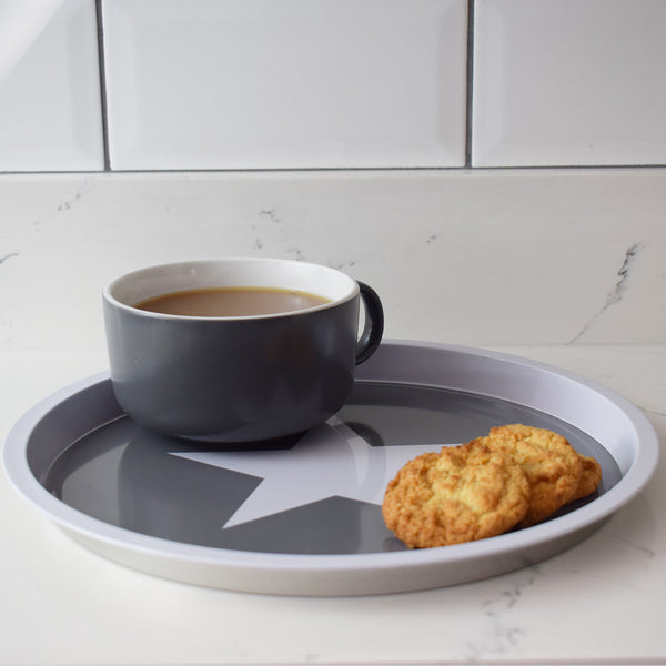 Grey Round Tray with Large White Star tea and biscuits
