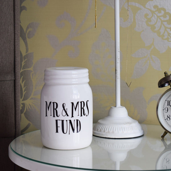 Mr & Mrs Fund Jar in bedroom