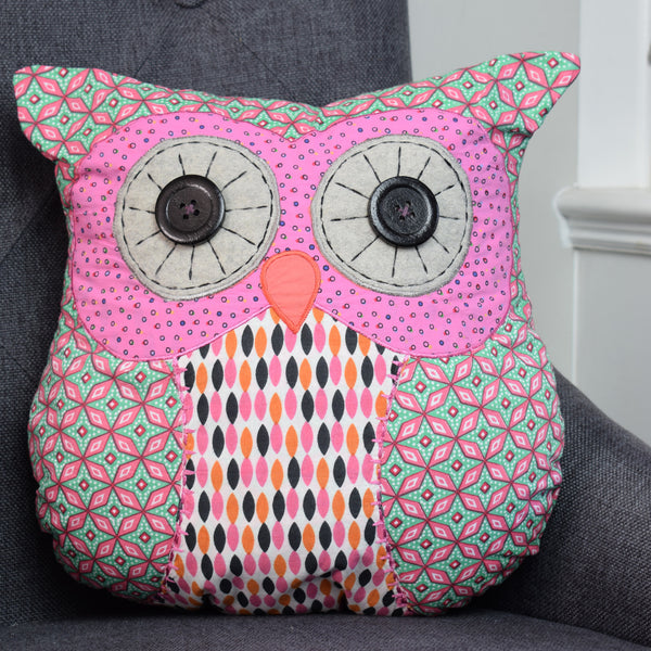 Penny the Owl Cushion on chair