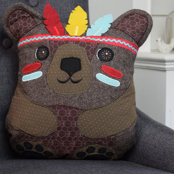 The Adventurous Bear Cushion on chair