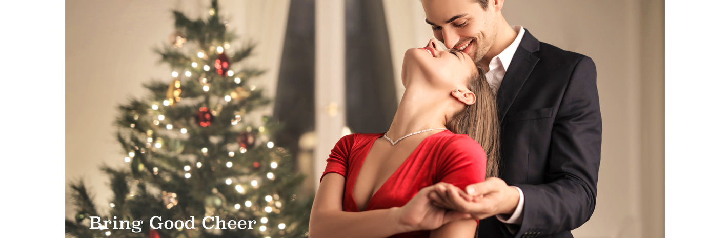 holiday gifts couple dancing by christmas tree