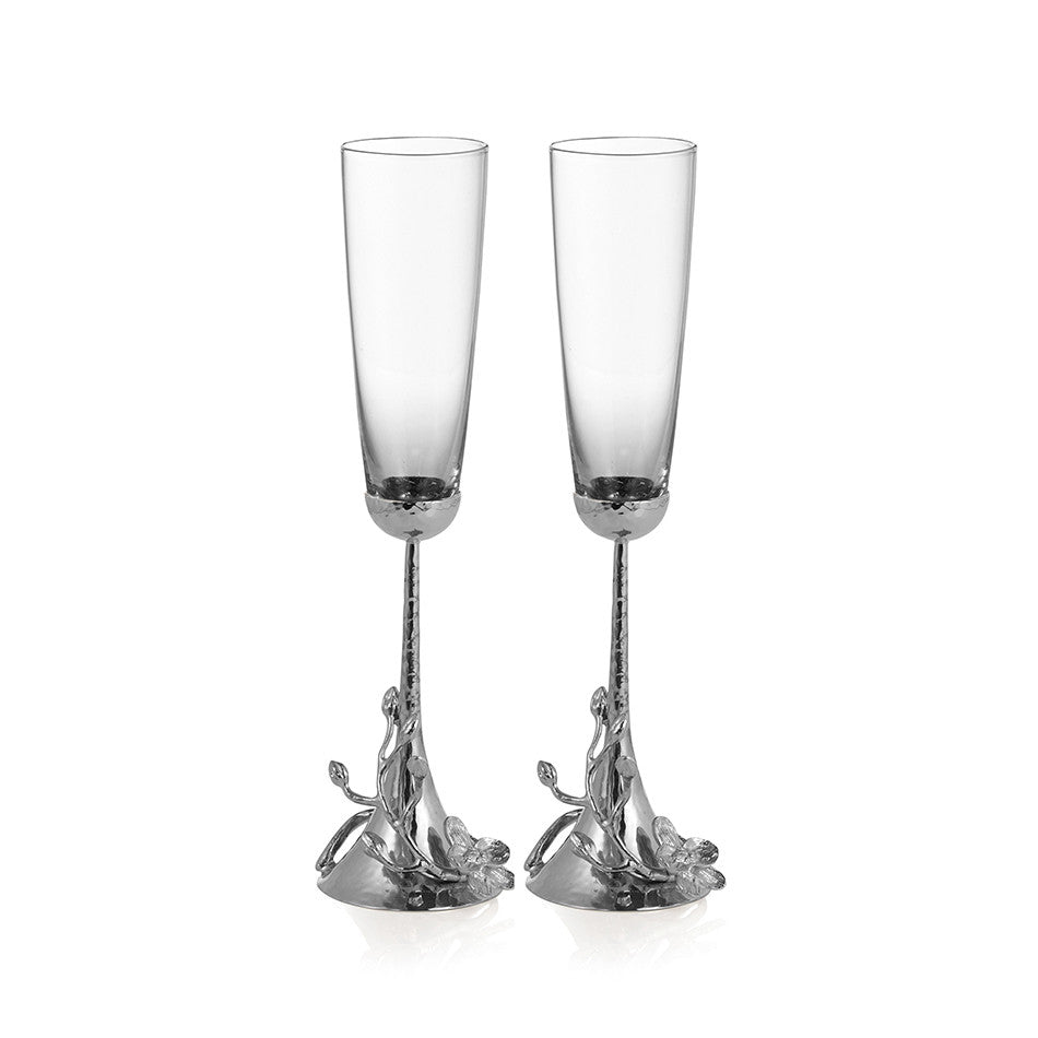toasting flutes with white orchids by michael aram