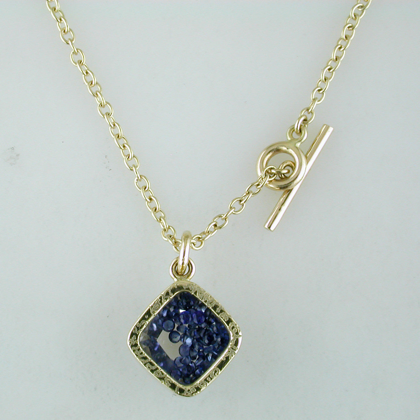 Moritz Glik 18K Yellow Gold Necklace Pendant Enclosed Loose Blue Sapphires
