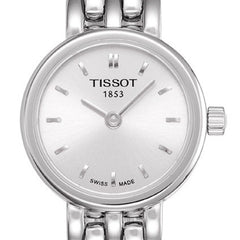 small face watch with a silver dial by Tissot