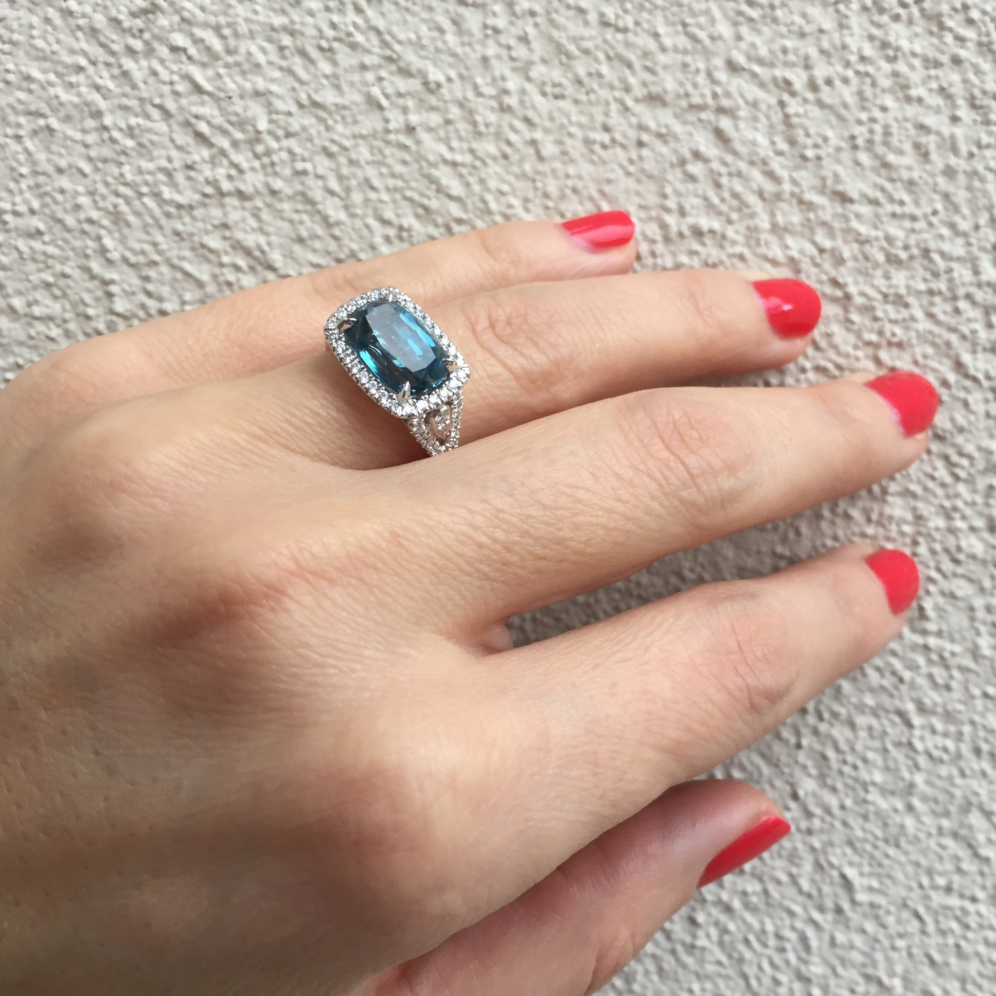 Doves London Blue Cushion Topaz Diamond Halo Rectangular Ring on model