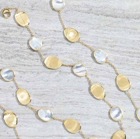 Marco Bicego necklace set in 18k yellow gold with alternating white mother of pearl Lunaria station