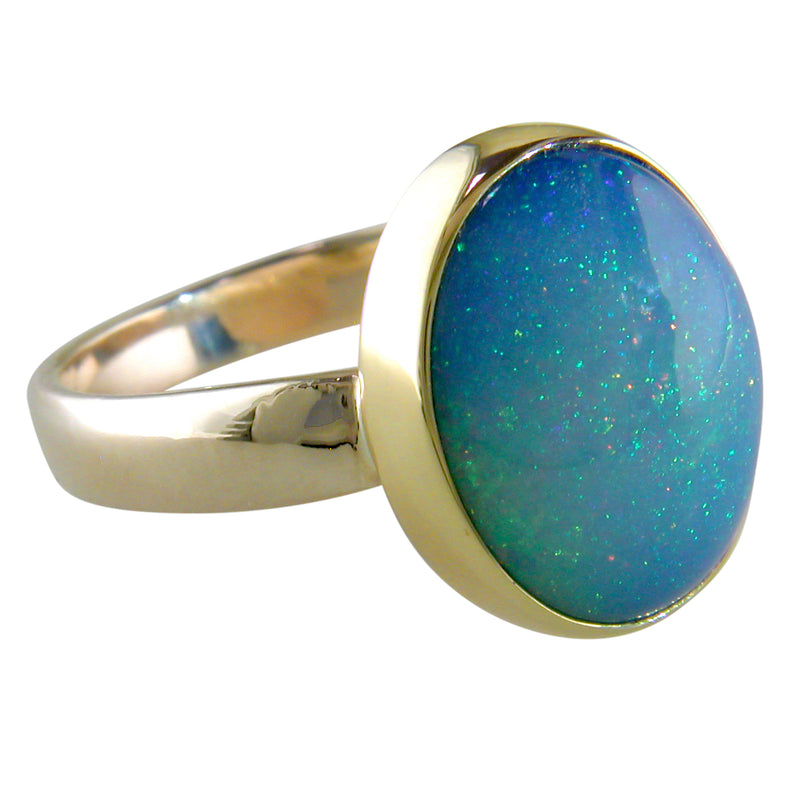 Ethiopian Opal Pinfire Oval Gold Ring