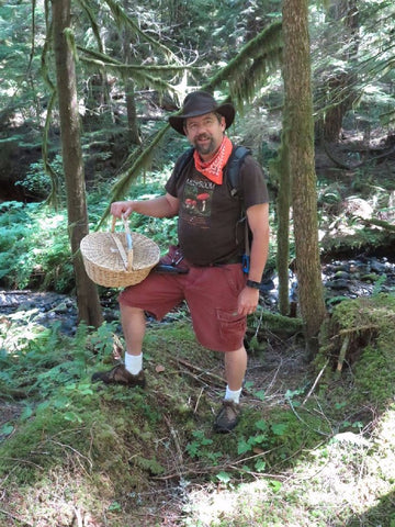 Larry Short, hunting for chanterelles and other early fall mushrooms, yesterday in the Gifford-Pinchot National Forest.