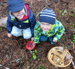Two young hunters enjoy looking at (but not harvesting) a beautiful Russula rosacea.