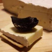 black garlic clove served on brie cheese...delicious!
