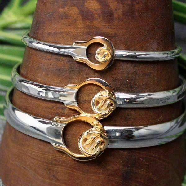 2-tone bracelet in Sterling silver and 14k gold with round Crucian knot design in 3 sizes.