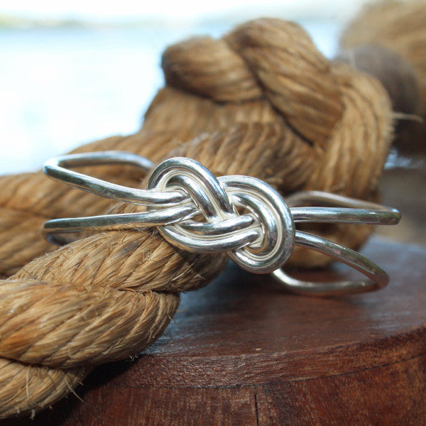 Sterling silver double infinity knot cuff bracelet.