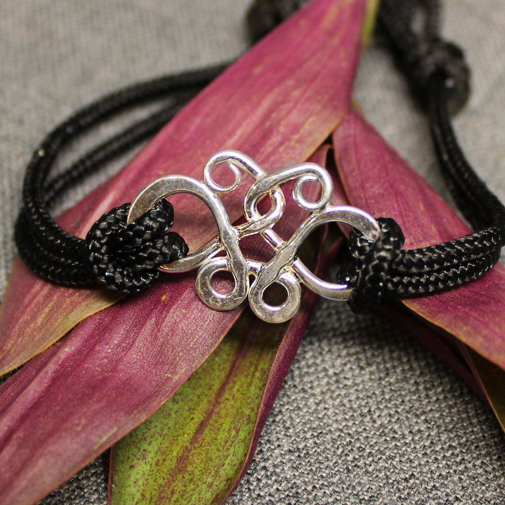 Butterfly jewelry - Black nylon cord bracelet with sterling silver butterfly effect charm.