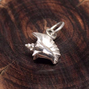 Sterling silver conch shell shaped charm.