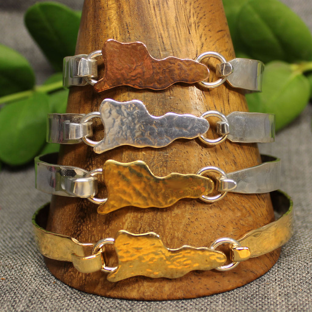 8mm latching bracelet with hammered map of St.Croix in center.