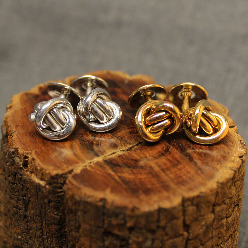 Small Sterling silver and 14k gold cufflinks with round Crucian knot design.
