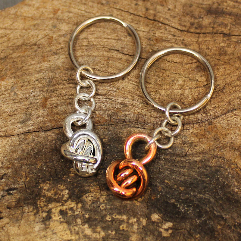 Sterling silver and coper keychains with Crucian Knot design.