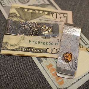 Sterling silver money clip with small round Crucian knot design.