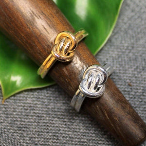 14k gold and Sterling silver Crucian knot rings.
