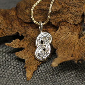 Sterling silver pendant with double infinity knot design.