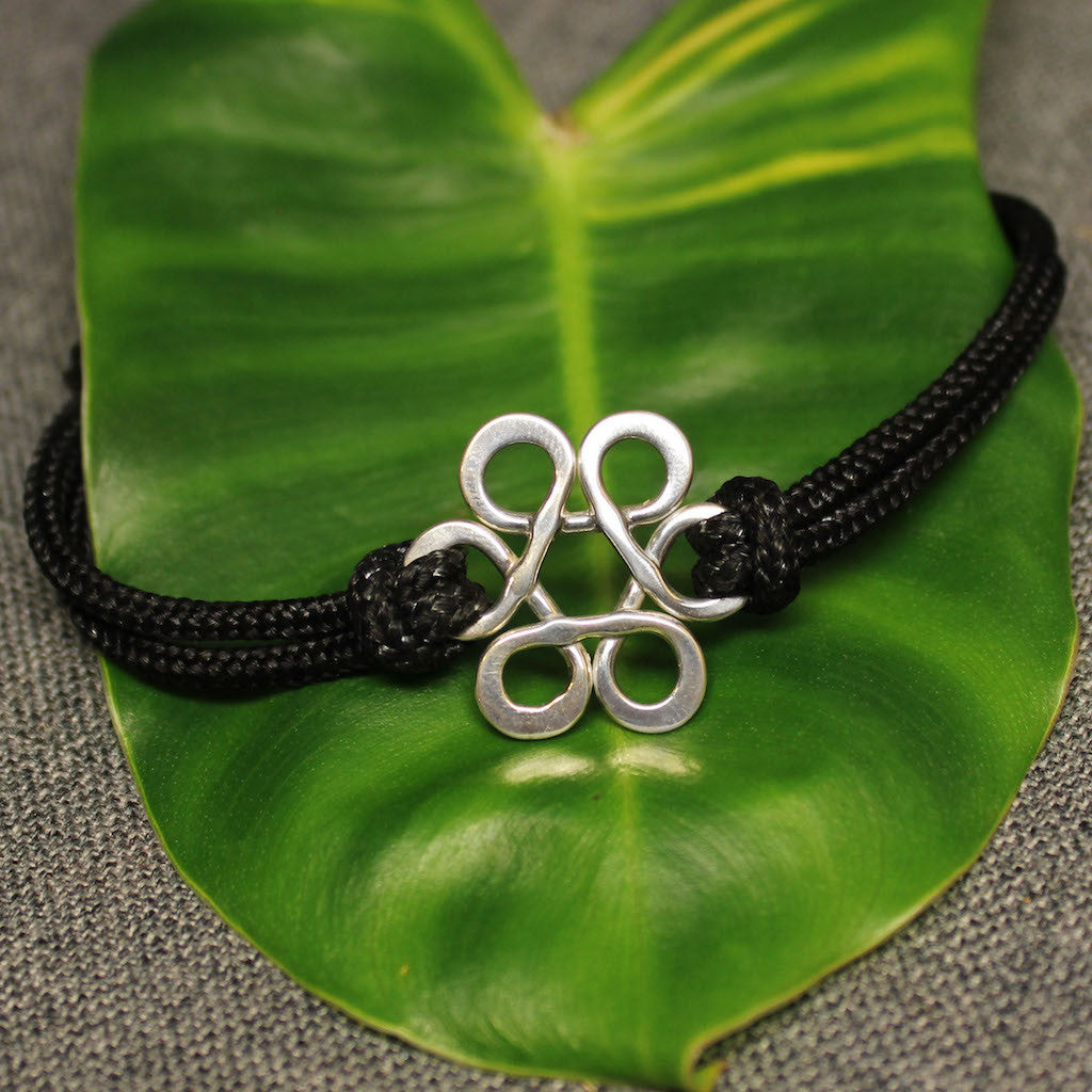 Sterling silver Flower of Life bracelet with black nylon adjustable cord.