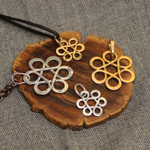 Small and large sterling silver and 14k gold pendants with Flower of Life design.