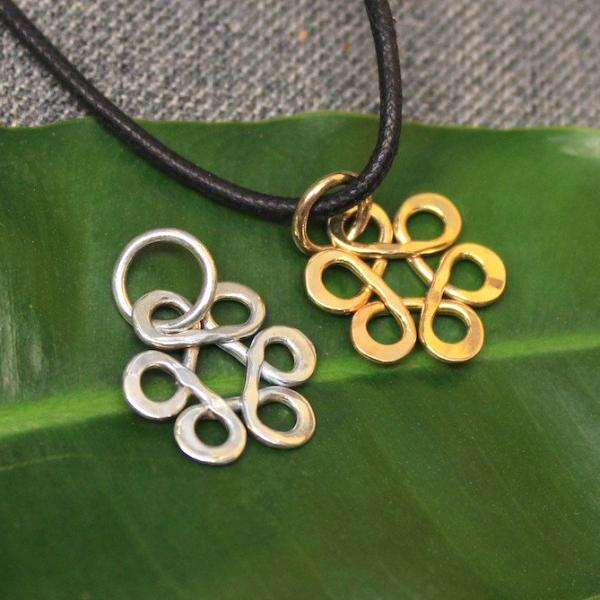 Sterling silver and 14k gold Flower of Life charm.