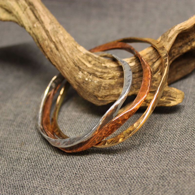 Handcrafted artisan bangles available in copper, sterling silver and 14k gold.