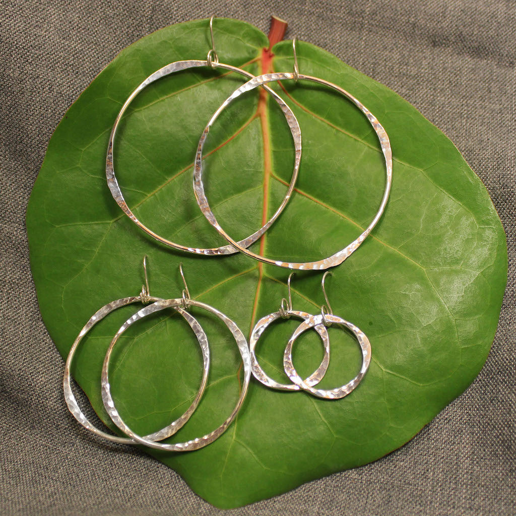 Small, medium and large handcrafted artisan sterling silver hoop earrings.