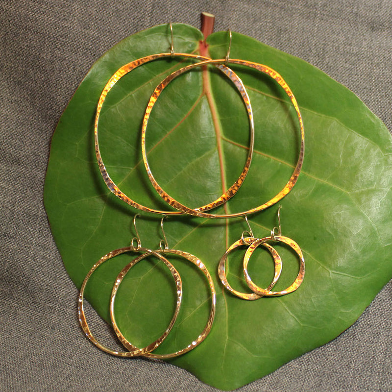 Small, medium and large handcrafted 14k gold hoop earrings.