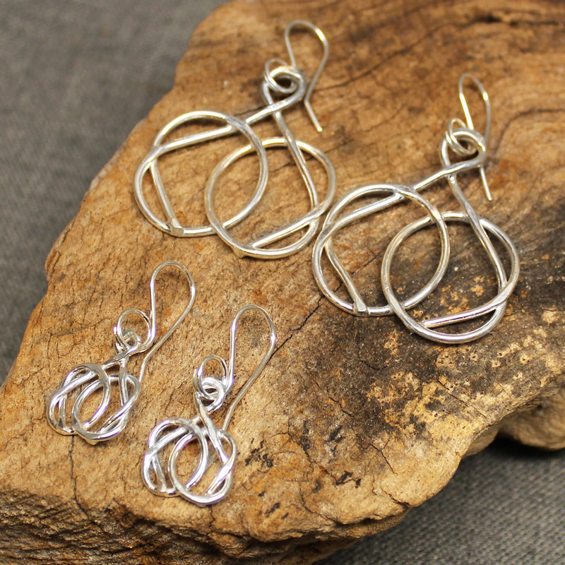 Small and large knot earrings with friendship knot design.